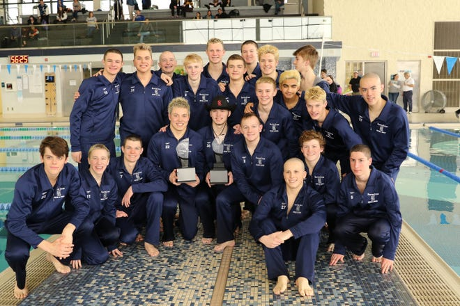 The South Lyon Unified boys swim and dive team poses after winning the 2019 LVC title.