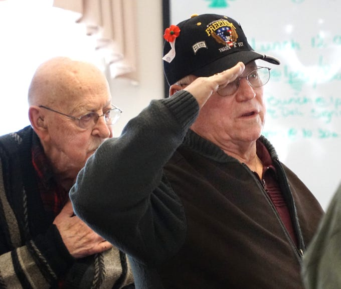 Veteran Jim Shipley salutes the American Flag as he says the Pledge of Allegiance.