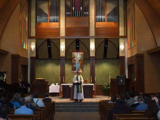 The Rev. Allen Kannapell speaks from the altar at His Church Anglican. The church, which has worshiped in several spaces across Livonia, recently purchased the former Trinity Church on Six Mile near Stevenson High School.