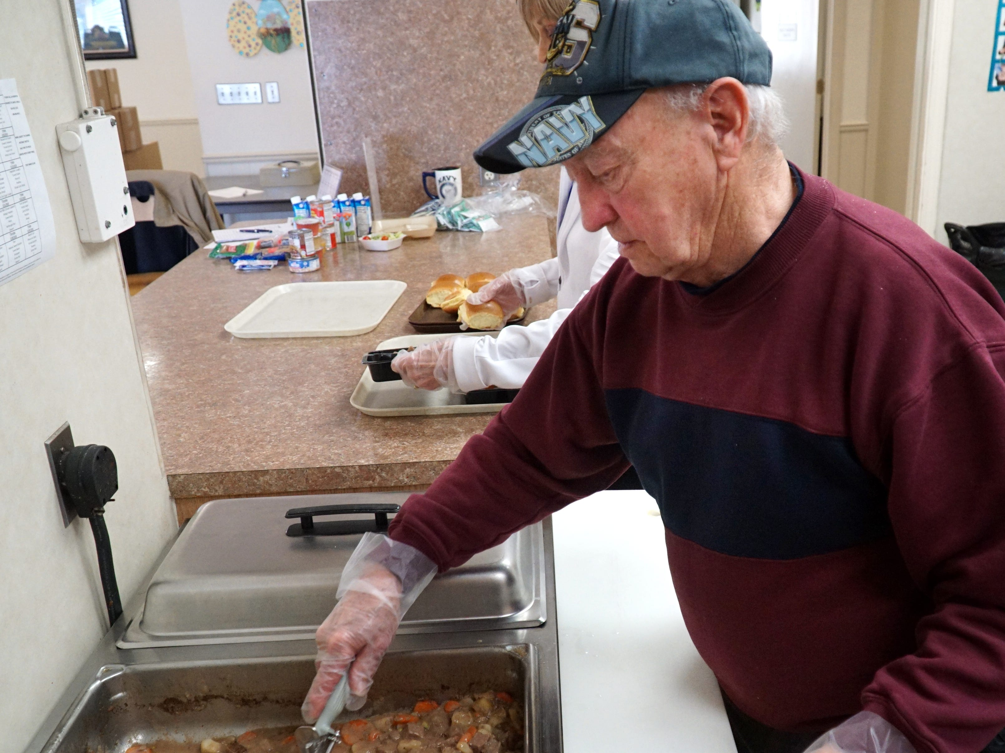 Roy Brandon helps to serve at the March 18 Veterans' Lunch at the Milford Senior Center.
