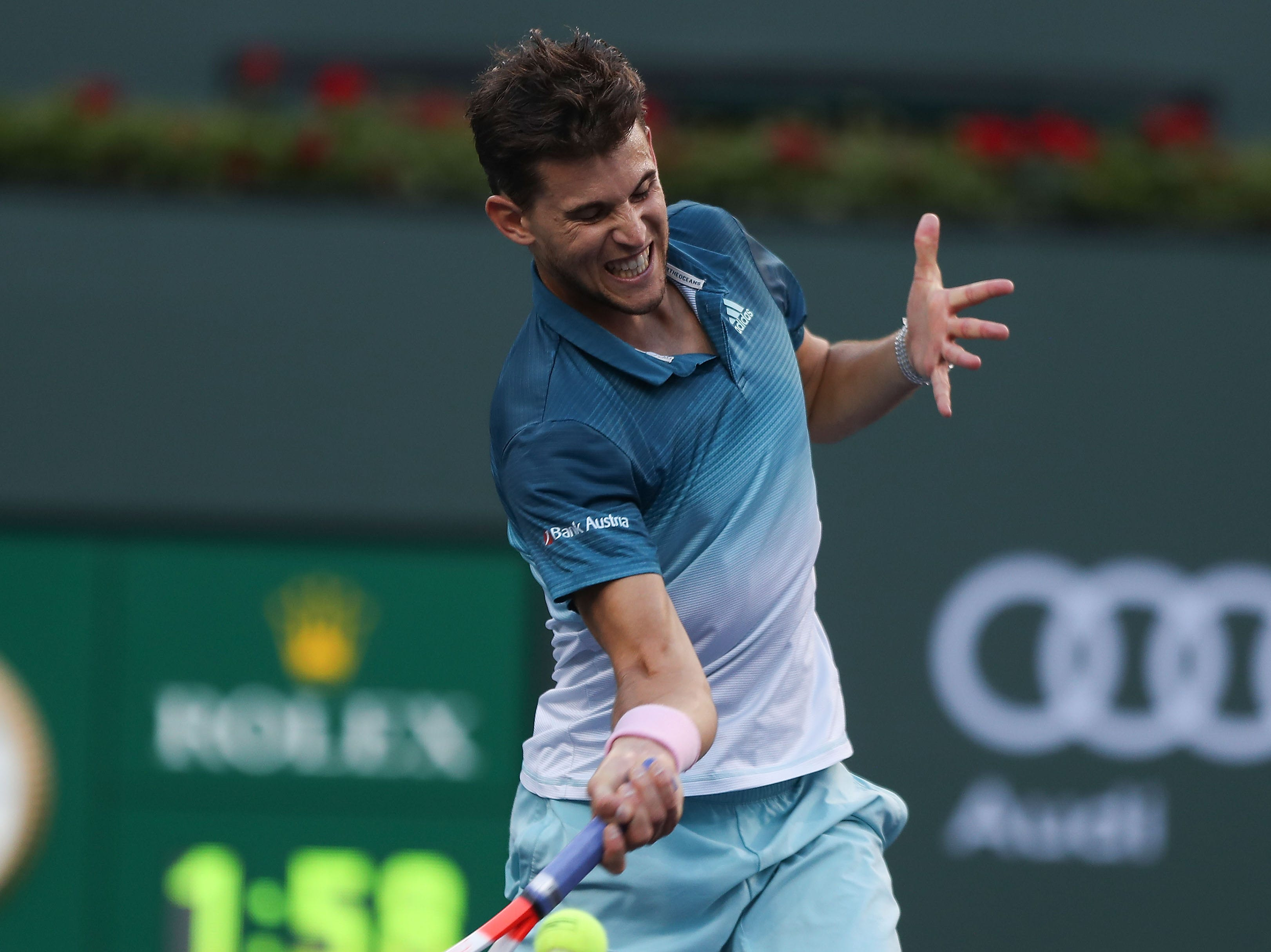 Dominic Thiem hits a shot during his win over Roger Federer at the Paribas Open final in Indian Wells, March 17, 2019.