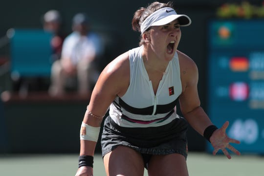 Bianca Andreescu reacts after winning a point in the third set of the finals of the BNP Paribas Open in Indian Wells, Calif., March 17, 2019.