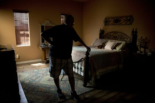"Doug Biggers, whose 20-year-old son, Landon, died of opioid overdose in 2017, pauses in a room where Landon died in La Quinta, Calif., on Tuesday, Aug. 14, 2018. For years Doug lived in shame, keeping Landon's addiction secret. He wasn't ashamed of his son but rather himself. Co-workers would talk about their children, going to college, getting married. Then they'd ask about his. ""How do you explain he's living in his car in a Walmart parking lot and trapped in a cycle of drug use and despair?"" he asks. ""How broken was this family that this could happen?"""