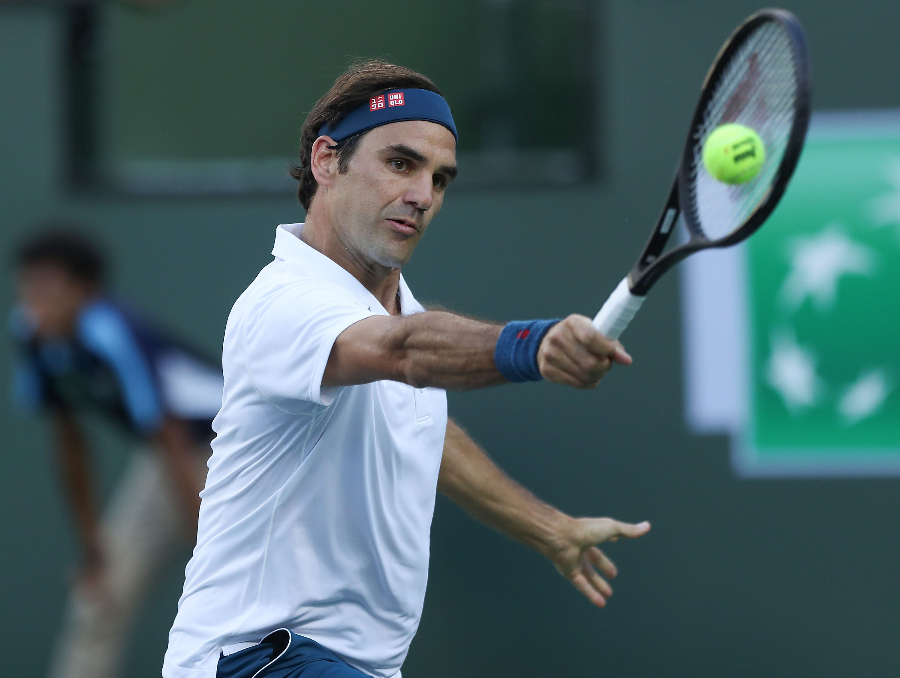 Roger Federer hits a shot during his loss to Dominic Thiem during the Paribas Open final in Indian Wells, March 17, 2019.