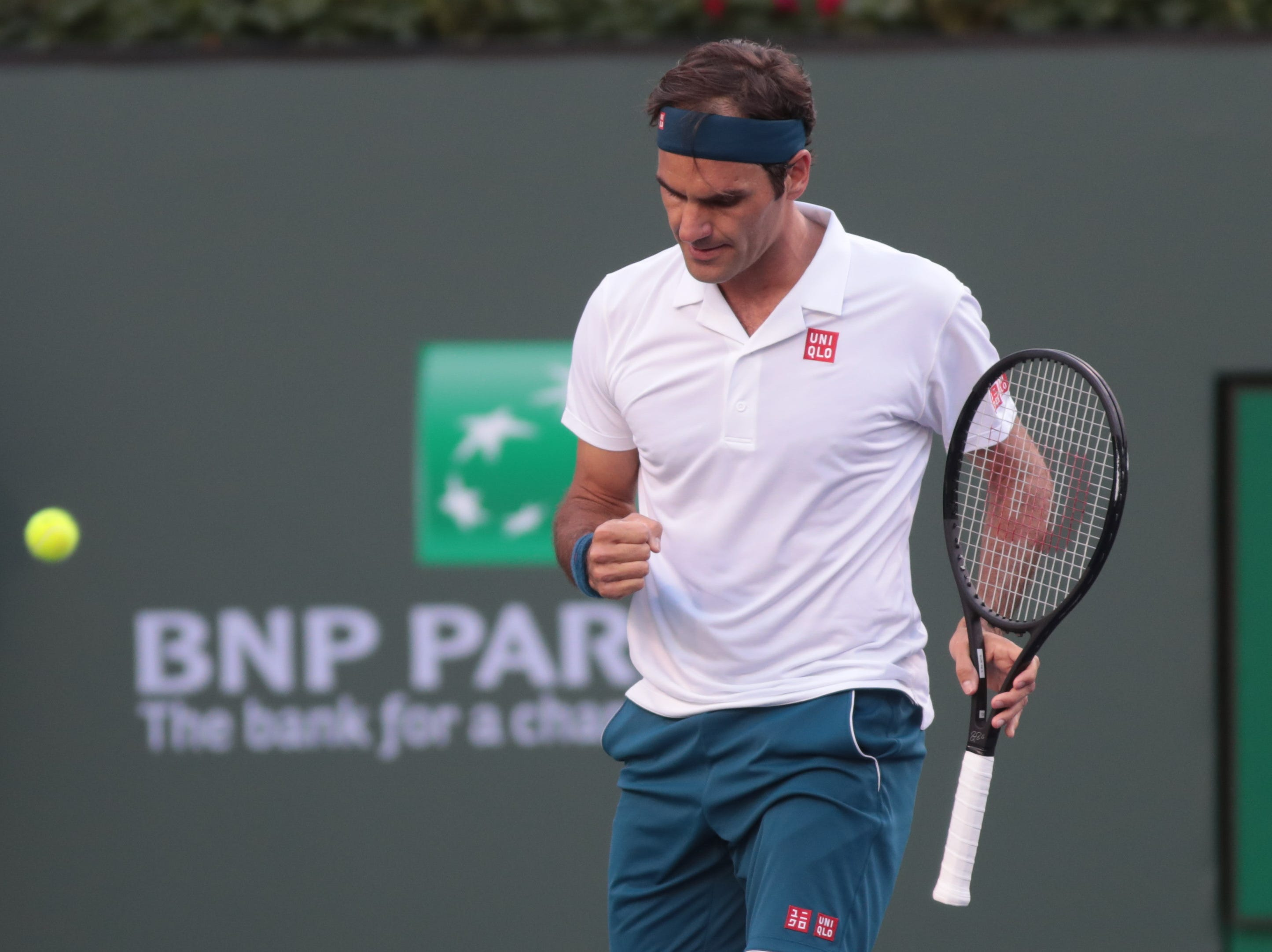 Roger Federer reacts to winning a point in the third set of the finals of the BNP Paribas Open in Indian Wells, Calif., March 17, 2019.