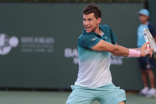 Dominic Thiem hits a backhand to Roger Federer in the third set of the finals of the BNP Paribas Open in Indian Wells, Calif., March 17, 2019.