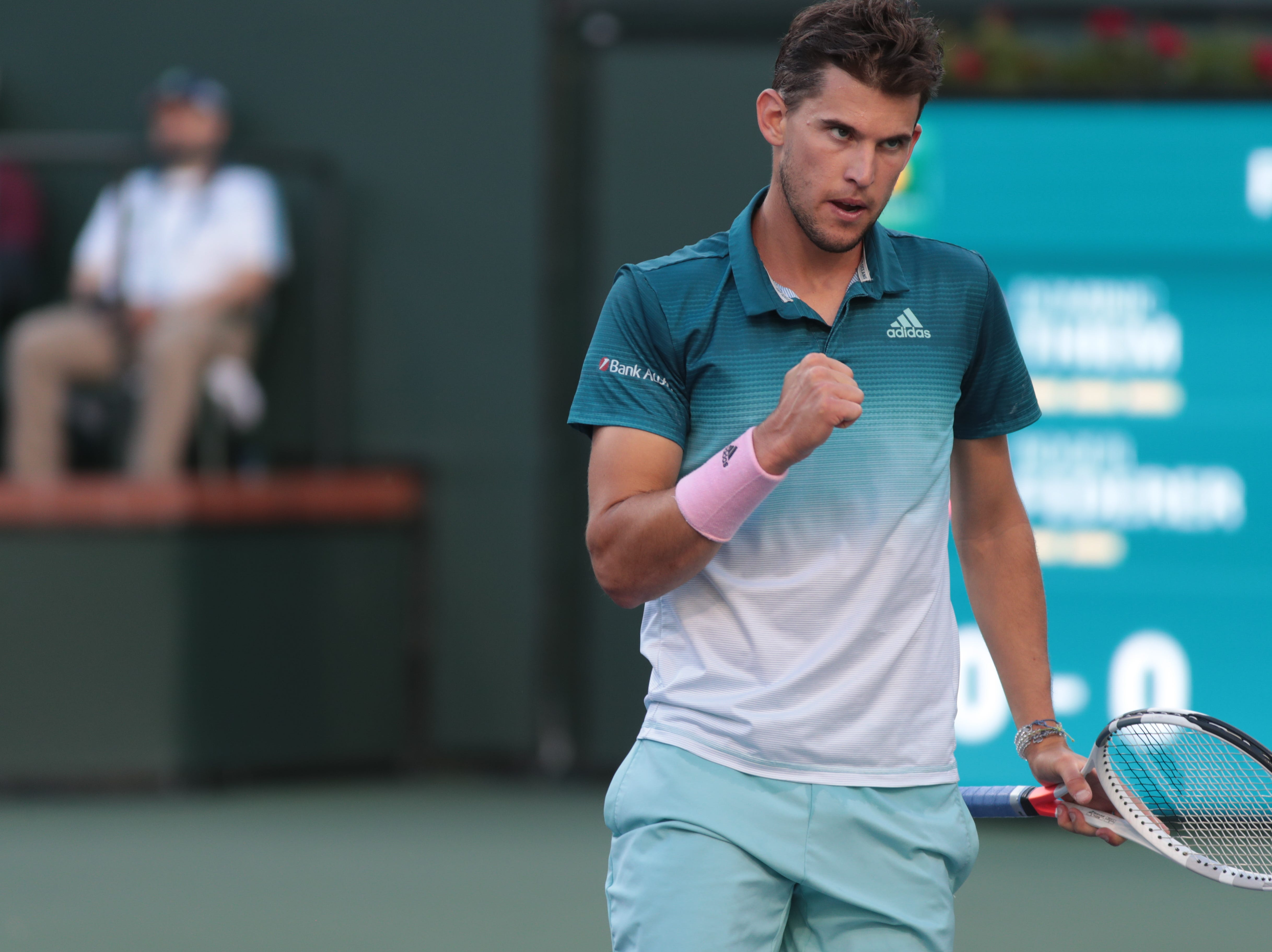 Dominic Thiem reacts after winning a point against Roger Federer in the finals of the BNP Paribas Open in Indian Wells, Calif., March 17, 2019.