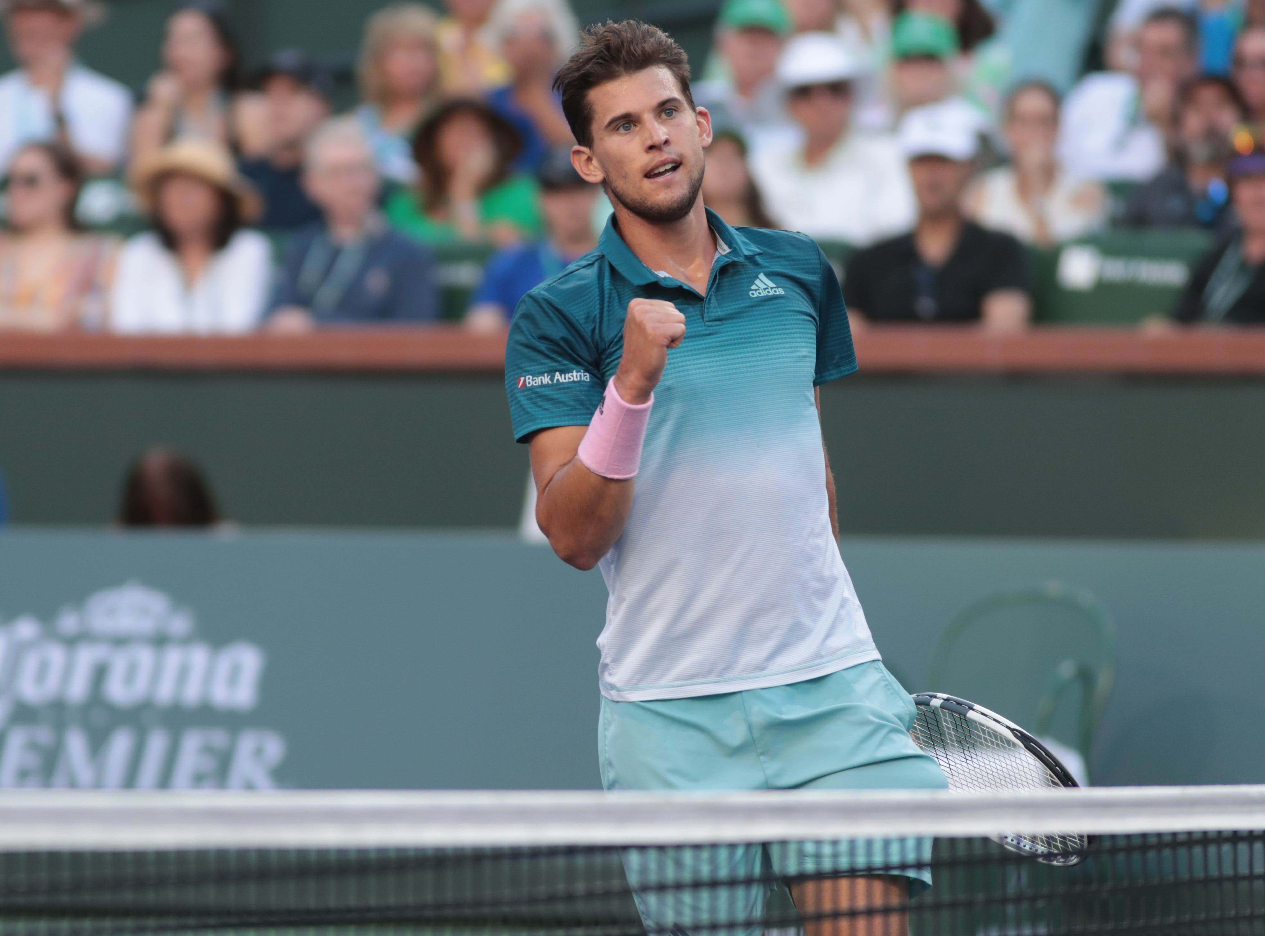 Dominic Thiem reacts after winning a point against Roger Federer in the third set of the finals of the BNP Paribas Open in Indian Wells, Calif., March 17, 2019.