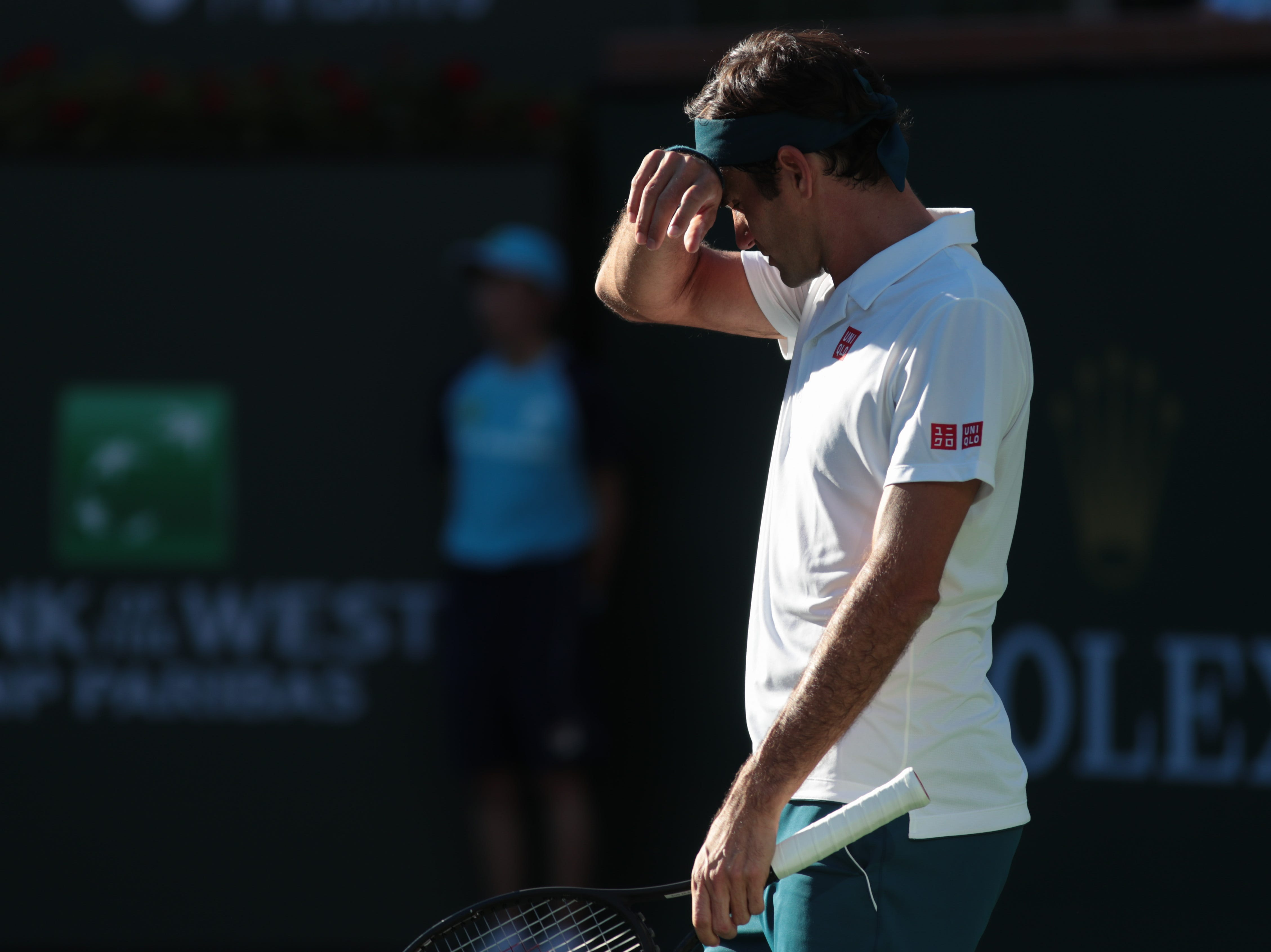 Roger Federer wipes sweat from his brow in the finals of the BNP Paribas Open in Indian Wells, Calif., March 17, 2019.