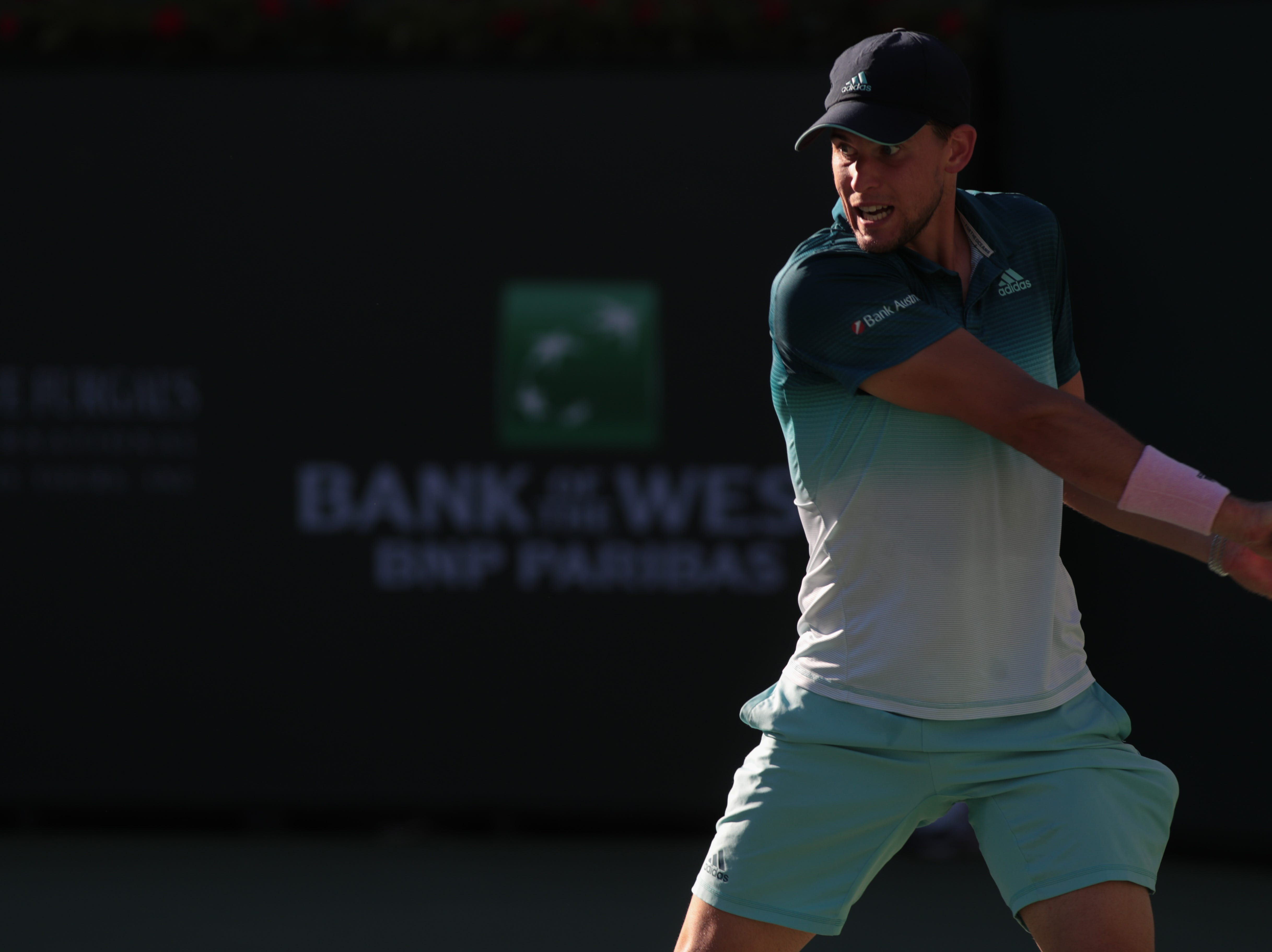 Dominic Thiem hits a backhand to Roger Federer in the finals of the BNP Paribas Open in Indian Wells, Calif., March 17, 2019.