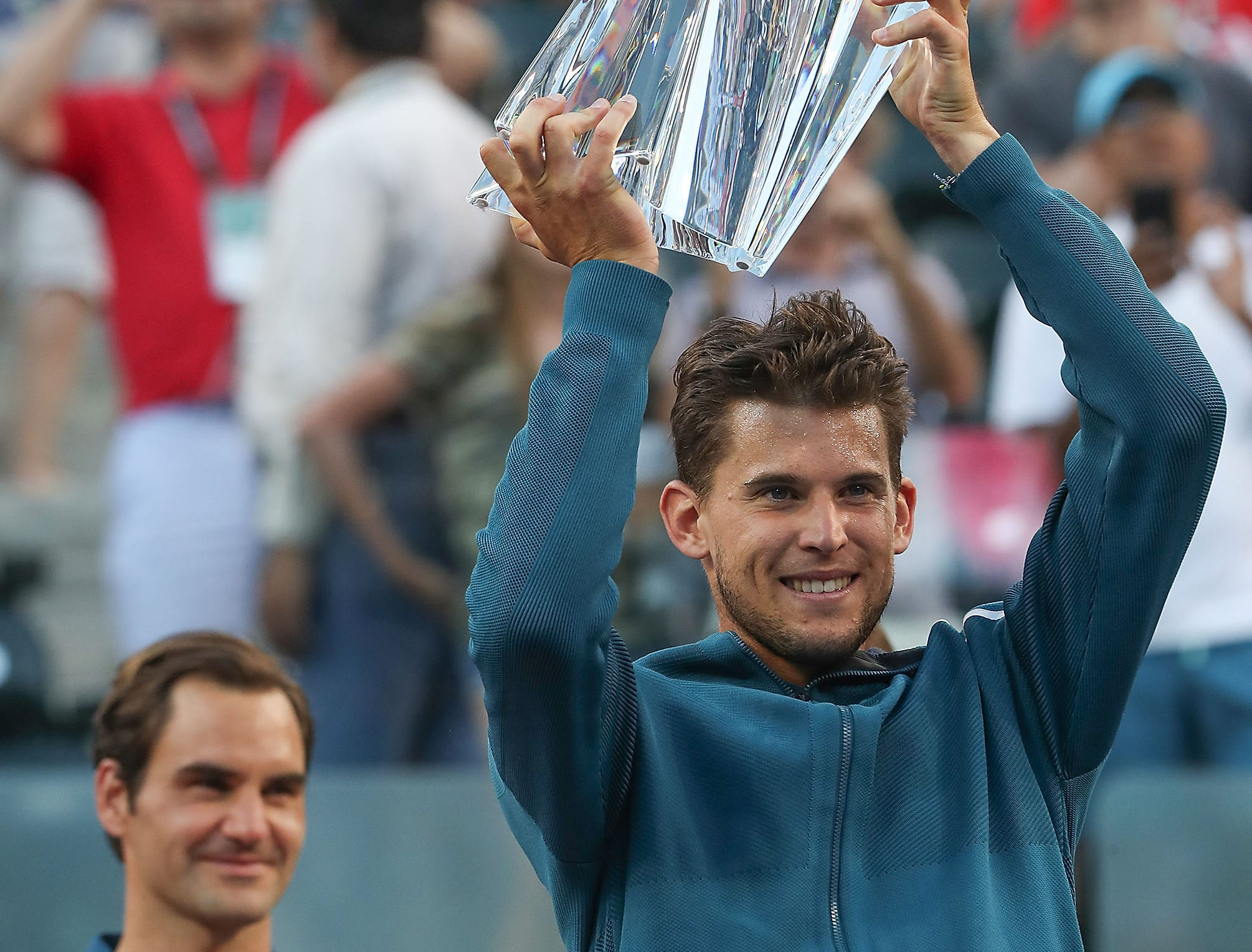 Dominic Thiem lifts the BNP Paribas Open tropyhy after his win over Roger Federer at the Paribas Open final in Indian Wells, March 17, 2019.