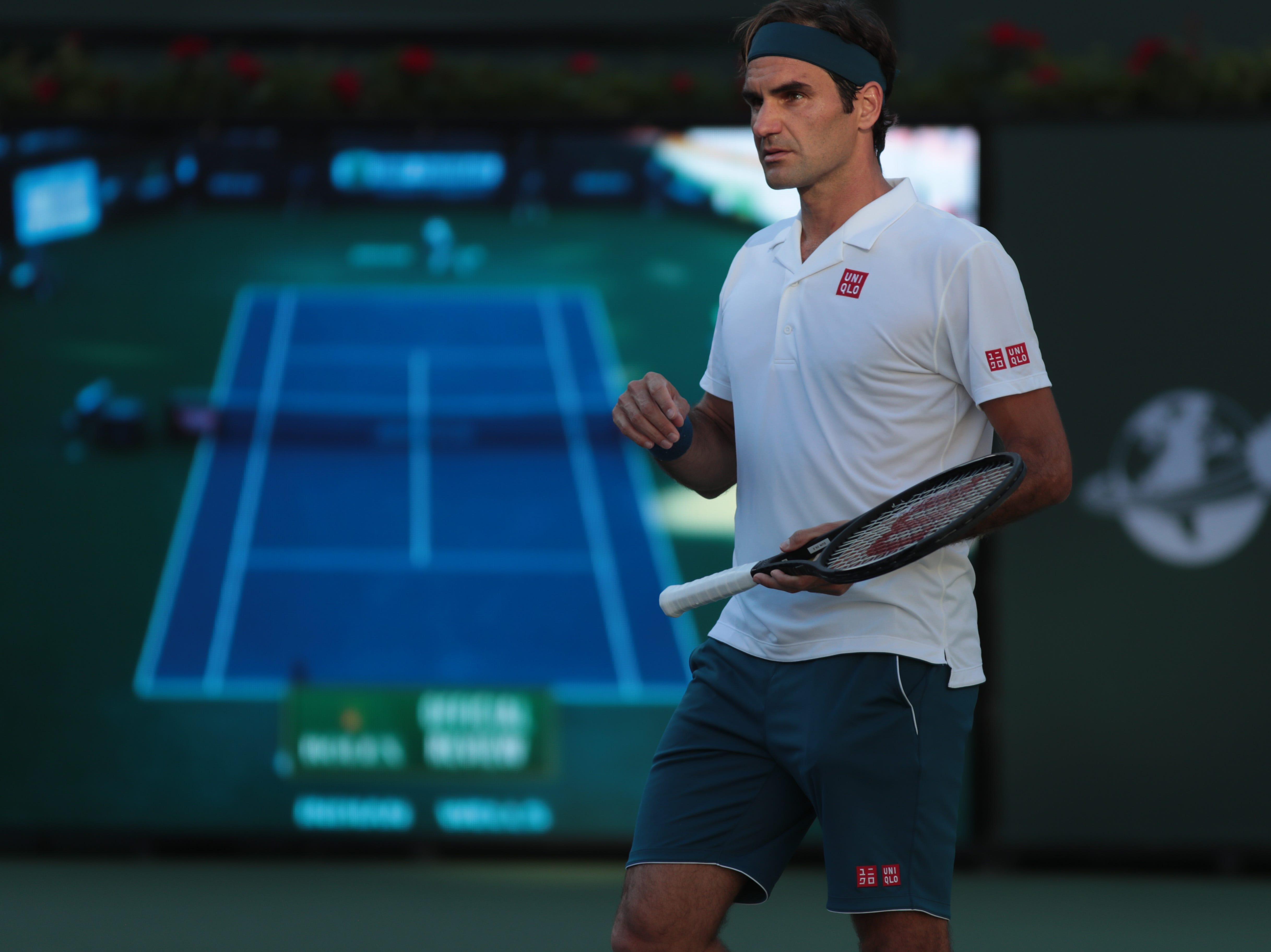 Roger Federer looks to the chair umpire after a call in the finals of the BNP Paribas Open in Indian Wells, Calif., March 17, 2019.