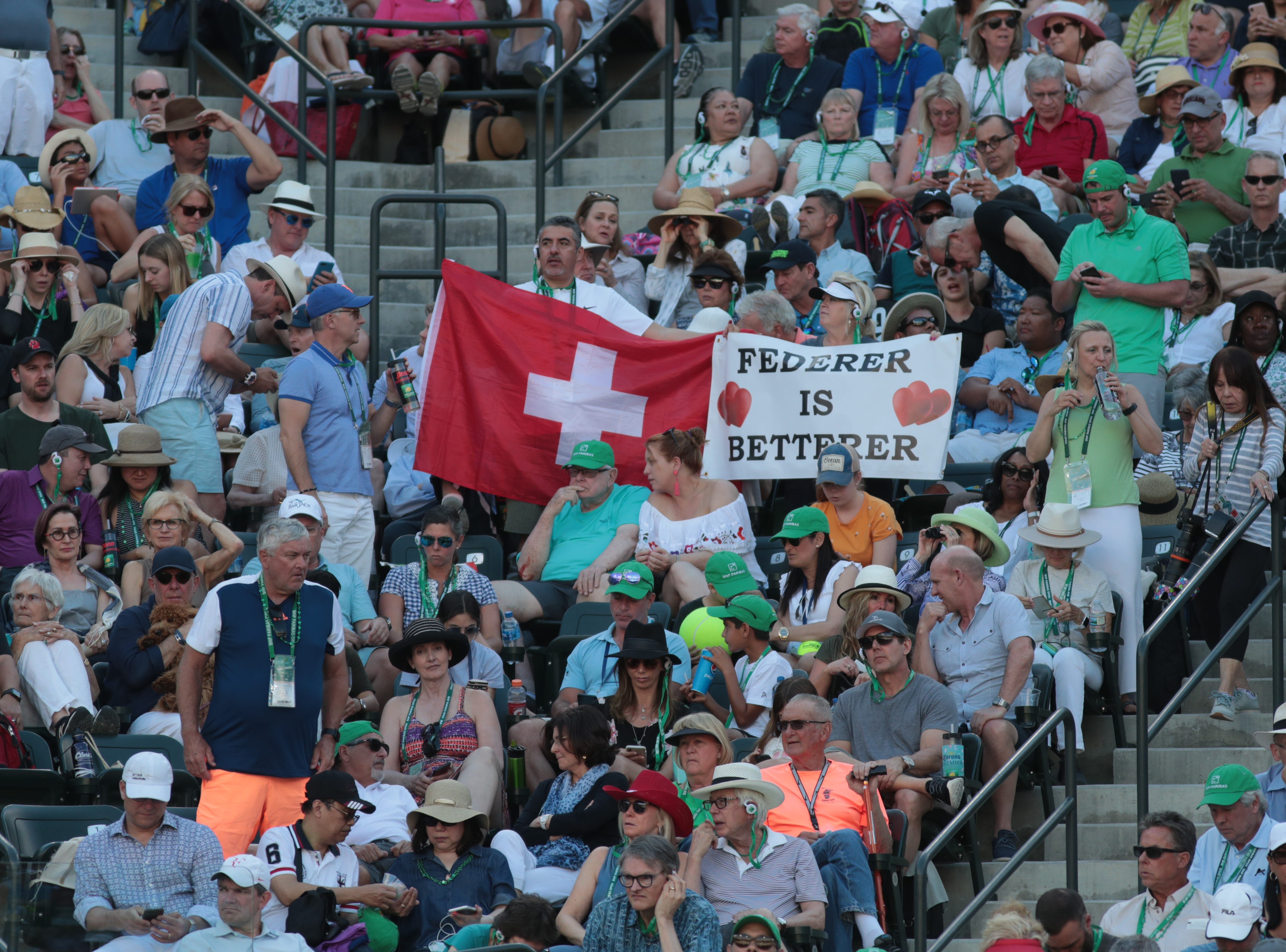 Fans cheer for Roger Federer in the finals of the BNP Paribas Open in Indian Wells, Calif., March 17, 2019.