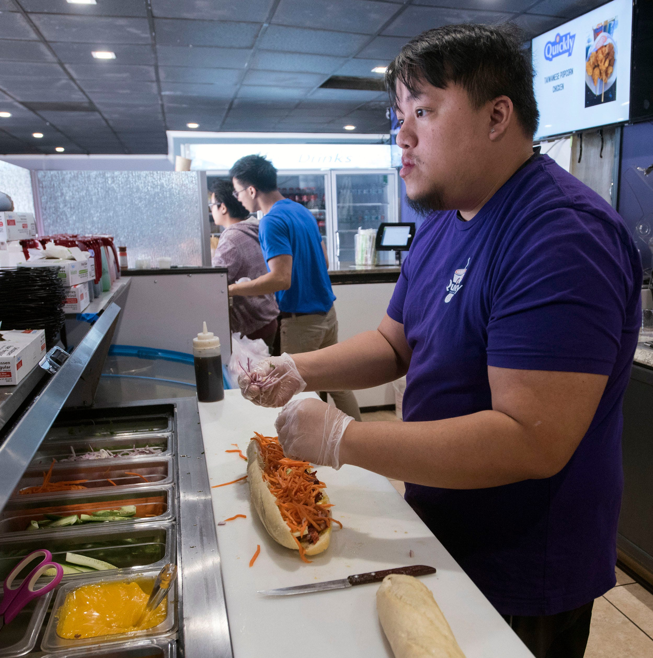 Jimmy Ho prepares a signature Banh mi sandwich at the new Quickly restaurant in Brownsville on Monday, March 18, 2019.