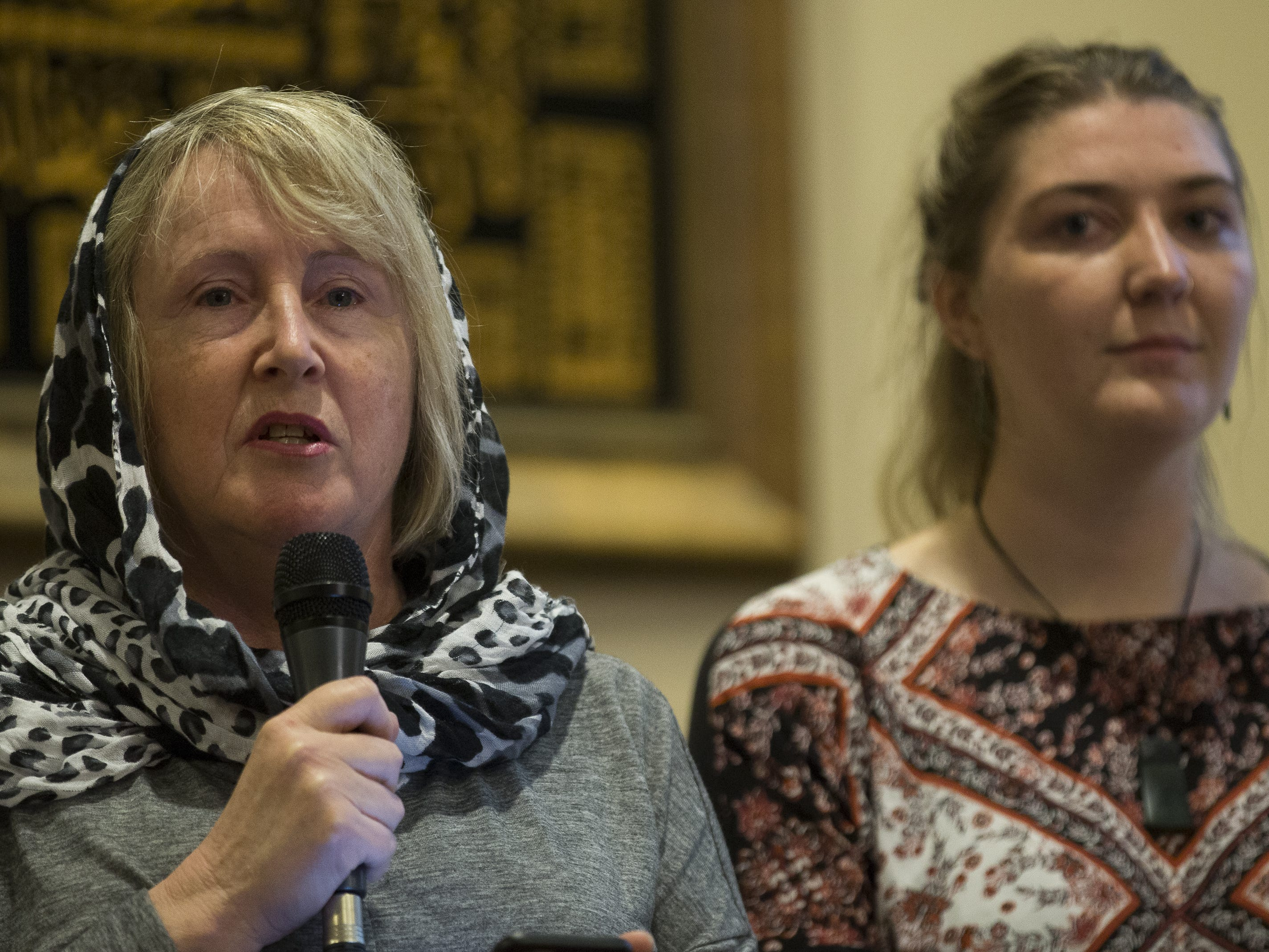Jo Quinn (left) from Christchurch New Zealand, and Ema Carol (right) from New Zealand, speak at a vigil held at the Islamic Center of Northeast Valley in Scottsdale, Ariz., on Sunday, March 17, 2019, in memory of the Christchurch New Zealand shooting victims.