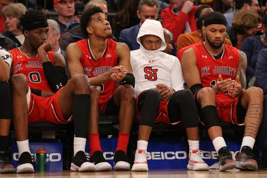 Mar 14, 2019; New York, NY, USA; St. John's Red Storm forward Sedee Keita (0) and guard Justin Simon (5) and guard Shamorie Ponds (2) and forward Marvin Clark II (13) react on the bench during the second half of a quarterfinal game of the Big East conference tournament against the Marquette Golden Eagles at Madison Square Garden. Mandatory Credit: Brad Penner-USA TODAY Sports
