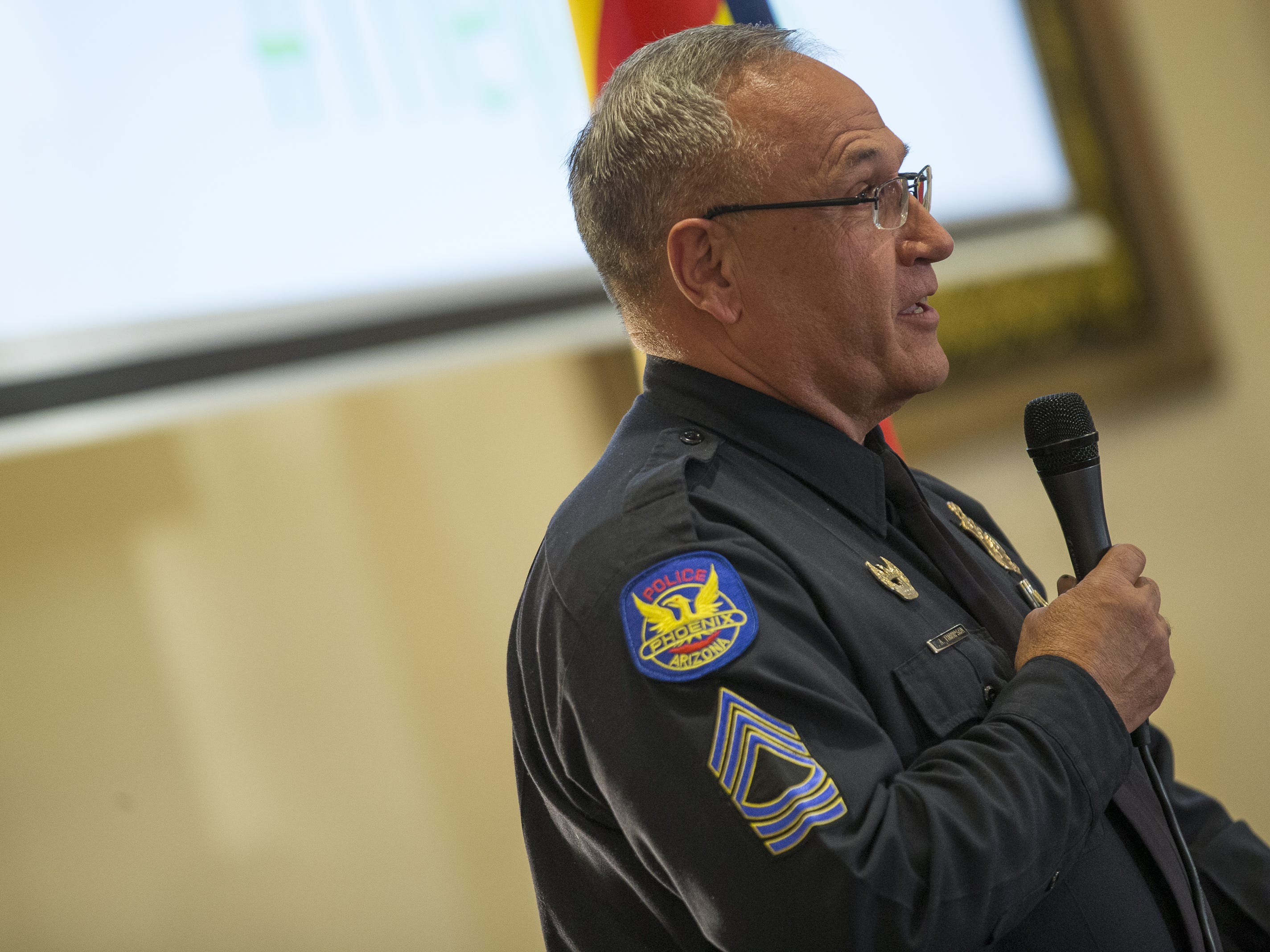 Phoenix Police Sgt. Tommy Thompson speaks at a vigil held at the Islamic Center of Northeast Valley in Scottsdale, Ariz., on Sunday, March 17, 2019, in memory of the Christchurch New Zealand shooting victims.