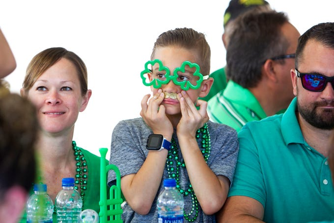 Jude Santefort, 8, celebrates St. Patrick's Day with his parents at Rosie McCaffrey's Irish Pub on March 17, 2019.