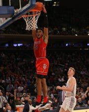Mar 14, 2019; New York, NY, USA; St. John's Red Storm guard Justin Simon (5) dunks against Marquette Golden Eagles guard Sam Hauser (10) during the second half of a quarterfinal game of the Big East conference tournament at Madison Square Garden. Mandatory Credit: Brad Penner-USA TODAY Sports