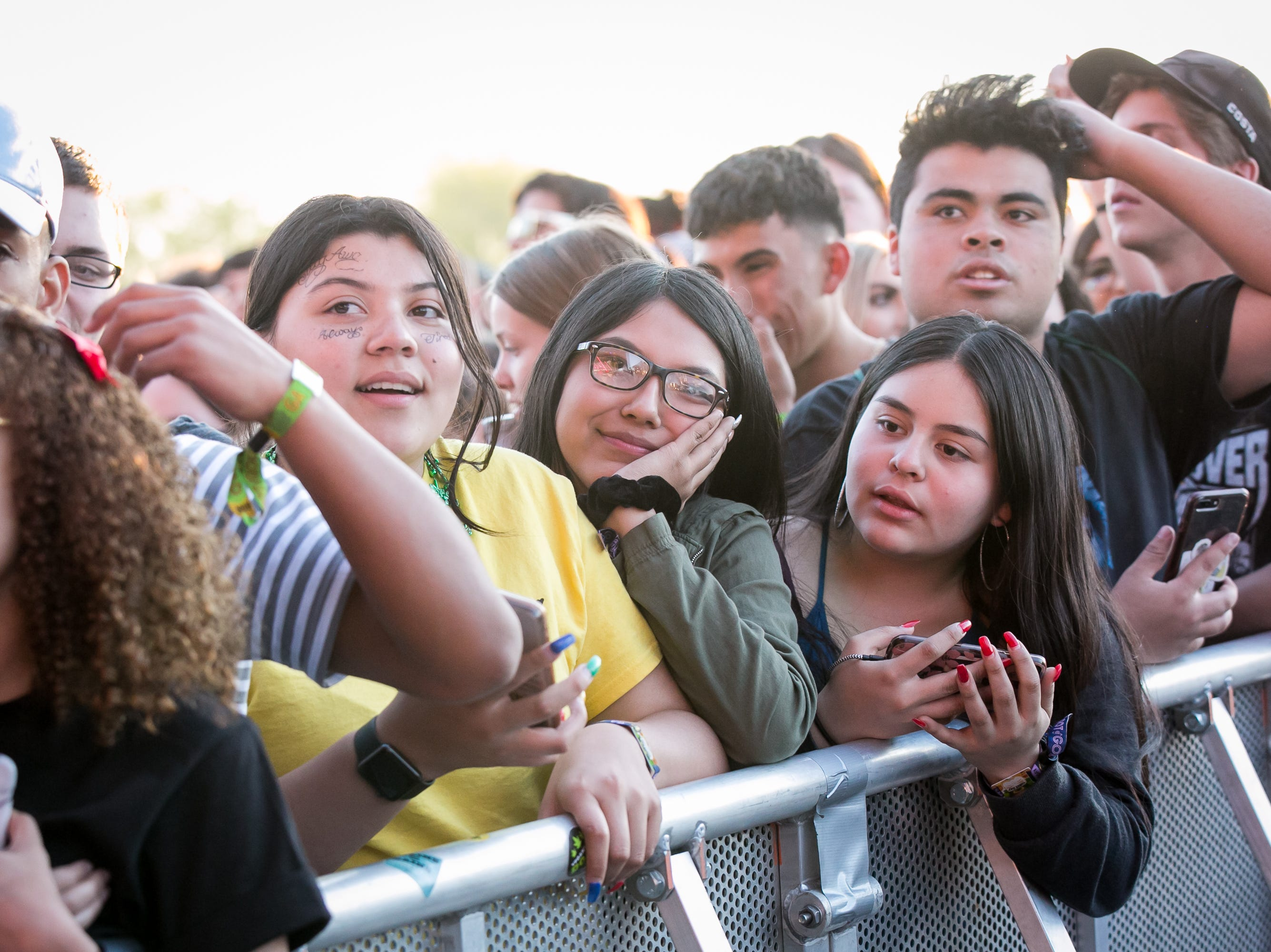 The girl in yellow paid a clever tribute to Post Malone's tattoos during Pot of Gold Music Festival on Sunday, March 17, 2019.