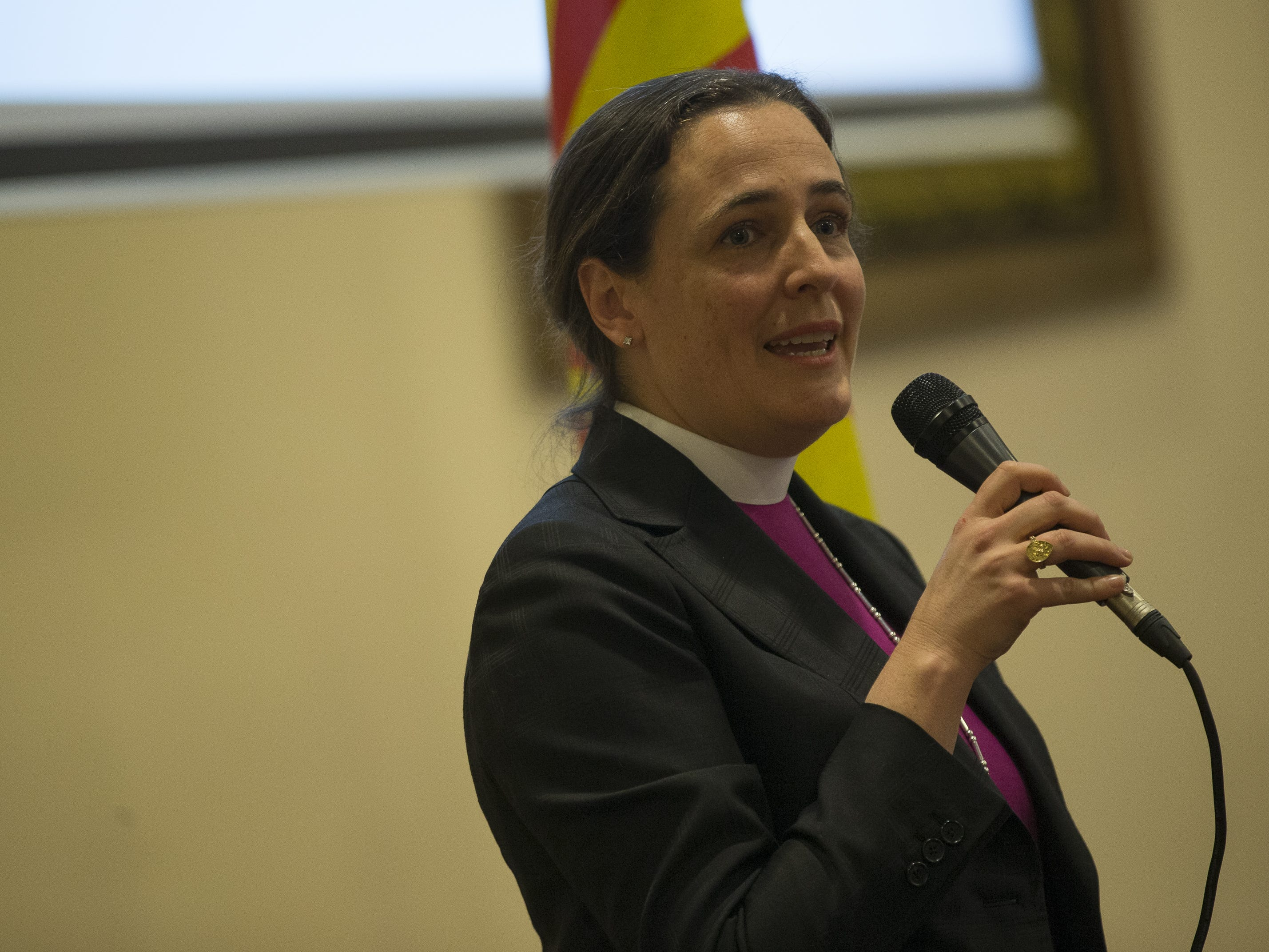 Bishop Jennifer Reddall, of the Episcopal Diocese of Arizona, speaks at a vigil held  at the Islamic Center of Northeast Valley in Scottsdale, Ariz., on Sunday, March 17, 2019, in memory of the Christchurch New Zealand shooting victims.