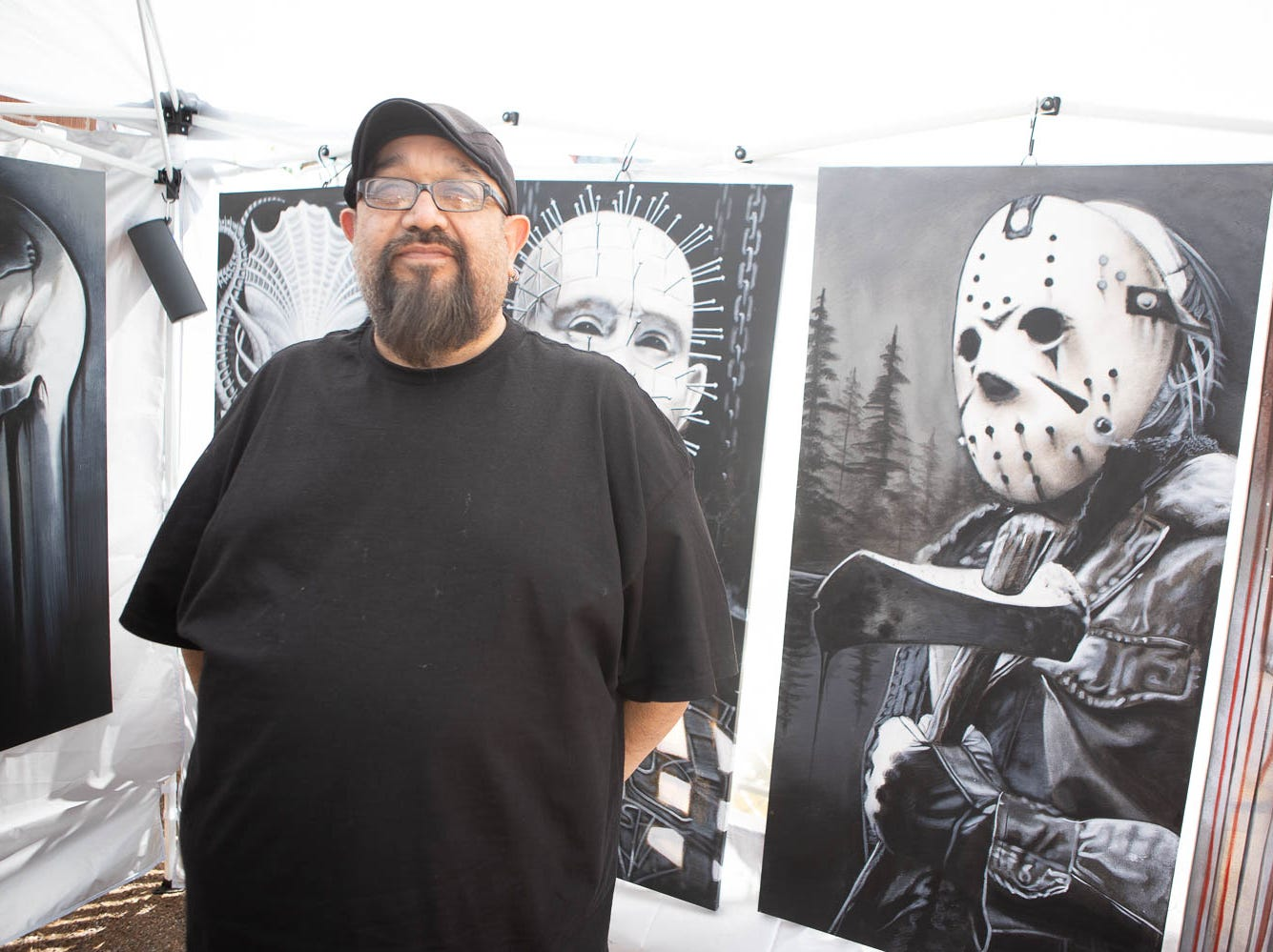 Sal Franco poses in front of some of his horror art pieces on March 16, 2019, in Phoenix during Art Detour.