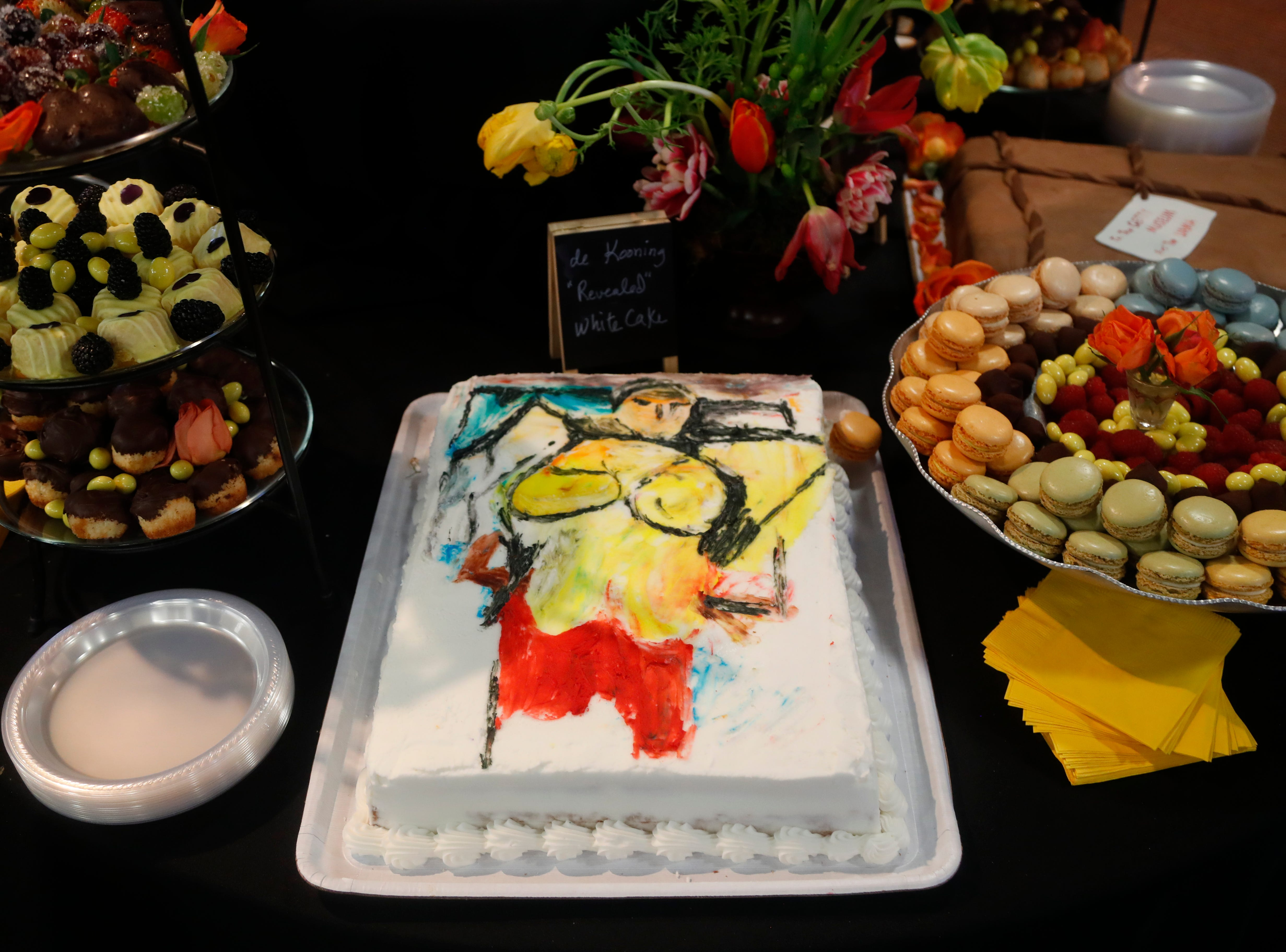 """A cake representing Willem de Kooning's """"Woman-Ochre,"""" stolen in 1985, is seen at a viewing of the newly recovered artwork at the University of Arizona Museum of Art in Tucson on March 17, 2019."""