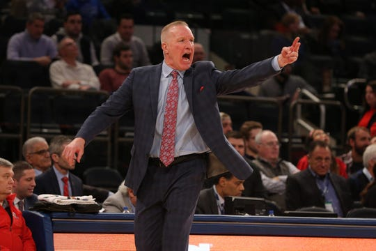St. John's Red Storm head coach Chris Mullin reacts as he coaches against the Marquette Golden Eagles during the first half of a quarterfinal game of the Big East conference tournament at Madison Square Garden.