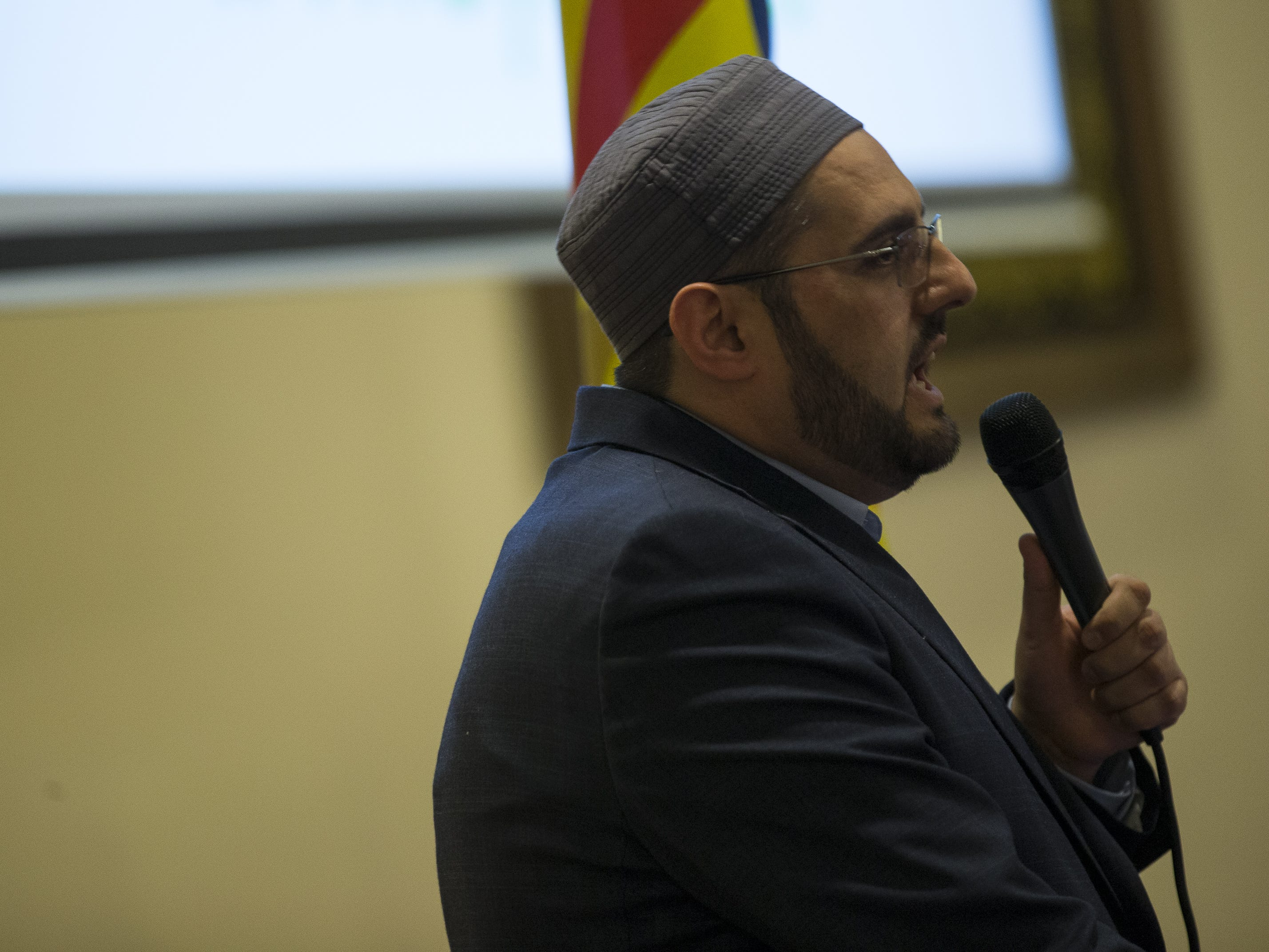Imaam Didmar Faja, of the United Islamic Center of Arizona, speaks at a vigil held at the Islamic Center of Northeast Valley in Scottsdale, Ariz., on Sunday, March 17, 2019, in memory of the Christchurch New Zealand shooting victims.
