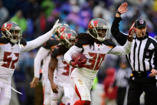 Buccaneers cornerback Josh Shaw (30) reacts after recovering a fumble during the third quarter of a game against the Ravens at M&T Bank Stadium.