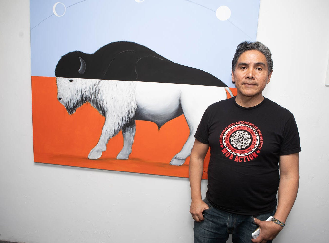 Artist Rafael Navarro stands with his work inside The Lodge on March 16, 2019, in Phoenix during Art Detour.