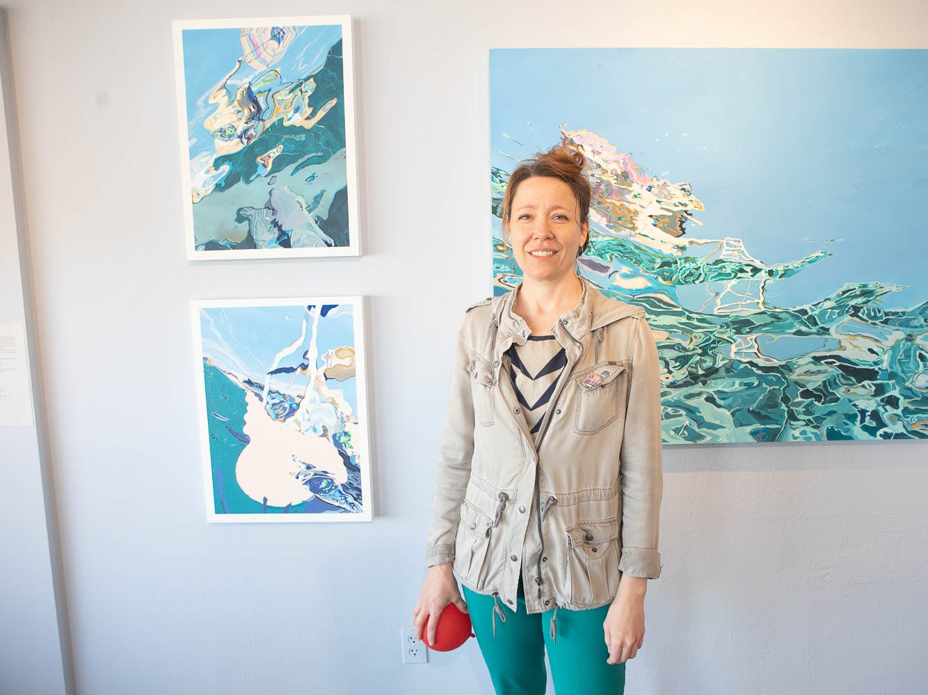 Abbey Messmer smiles with her work at The Lodge on March 16, 2019, in Phoenix during Art Detour.