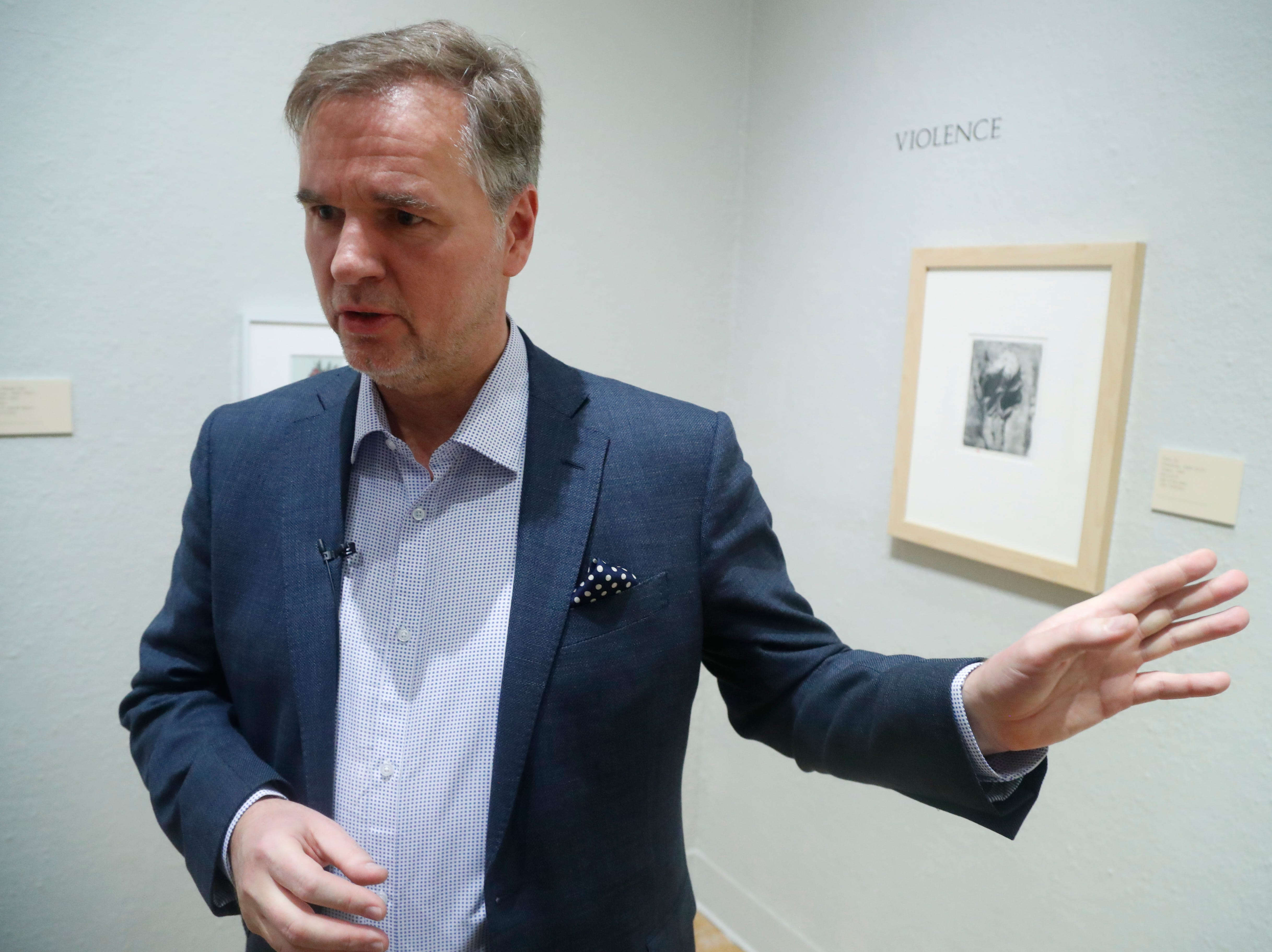 """Getty Museum's Ulrich Birkmaier talks with people at the University of Arizona Museum of Art in Tucson on March 17, 2019. Birkmaier will work on restoring Willem de Kooning's """"Woman-Ochre,"""" a painting stolen in 1985 from the college."""