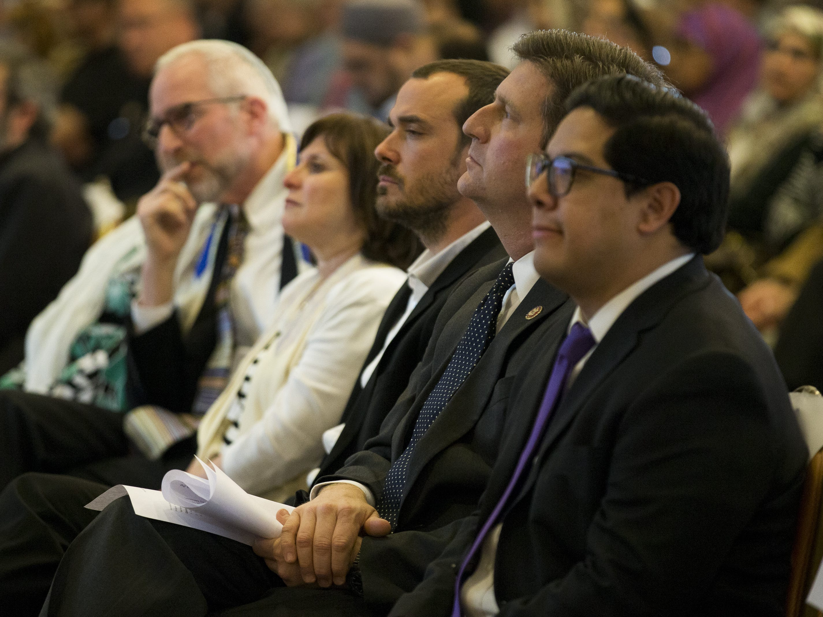U.S. Rep. Greg Stanton (second from right) sits at a vigil held at the Islamic Center of Northeast Valley in Scottsdale, Ariz., on Sunday, March 17, 2019, in memory of the Christchurch New Zealand shooting victims.