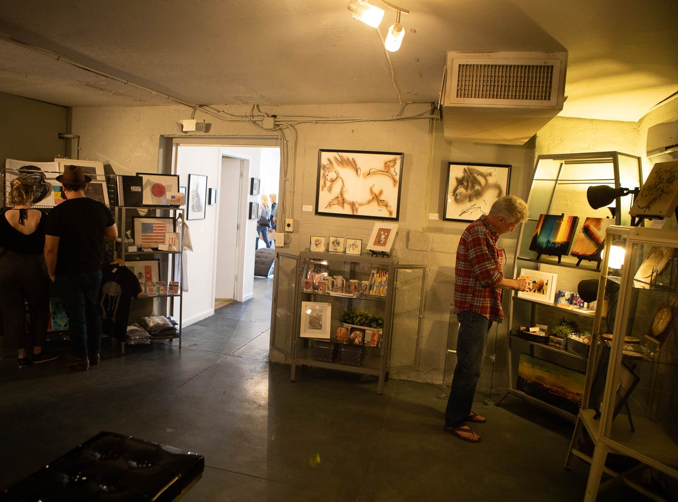 Visitors rummage through galleries looking for the right purchase on March 16, 2019, in Phoenix during Art Detour.