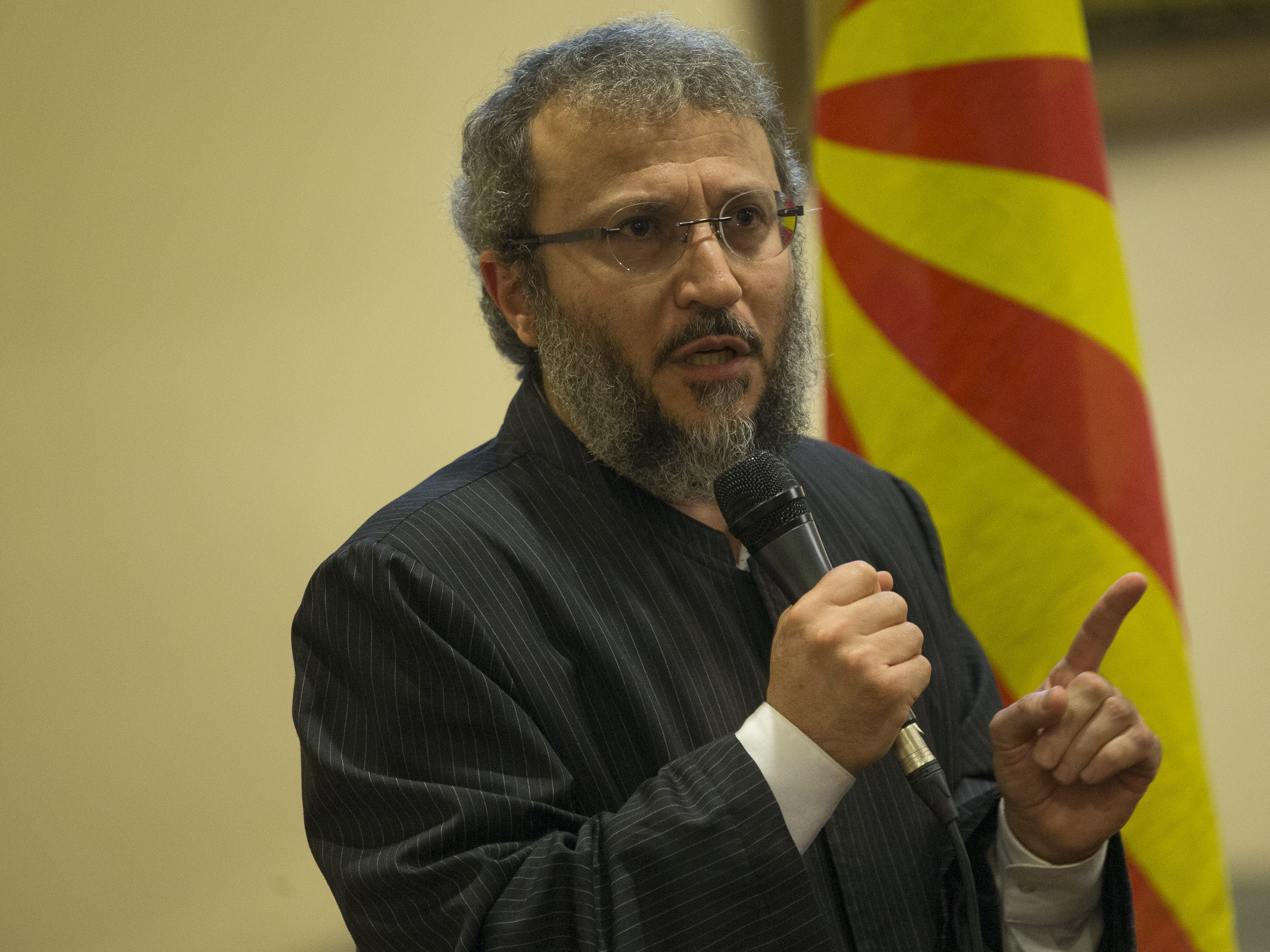 Imaam Anas Hlayhel, of Masjid As Salaam, speaks at a vigil held at the Islamic Center of Northeast Valley in Scottsdale, Ariz., on Sunday, March 17, 2019, in memory of the Christchurch New Zealand shooting victims.