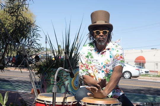 A musician provides percussion on Grand Avenue in Phoenix on March 16, 2019, during Art Detour.