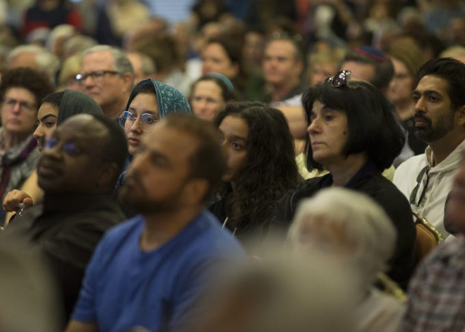 People of different faiths and backgrounds gather together at the Islamic Center of Northeast Valley in Scottsdale, Ariz., on Sunday, March 17, 2019, in memory of the Christchurch New Zealand shooting victims.