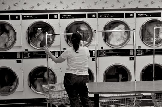 """Randy Calderone's """"Ithaca Laundromat"""" is featured in the exhibit, """"Artists Respond to Poetry."""""""