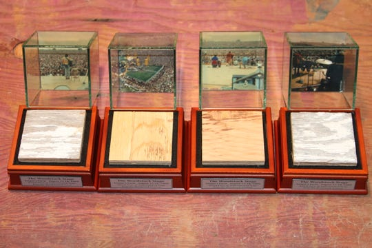 Pieces of the original stage of the Woodstock Music and Art Festival sit in display cases with photos of the event in 1969. Steve Gold, of Rockland County, is selling the items and also lent six panels to The Museum at Bethel Woods.