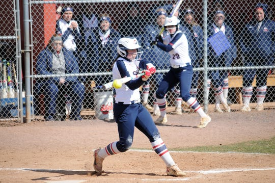 Courtney Coy times up a pitch for Shippensburg softball