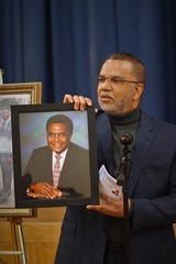 Vernon Bracey presenting photo of Ray Crenshaw to Crispus Attucks.