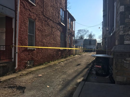 An alley by South West Street and West King Street in York City is blocked off as police investigate a homicide Sunday afternoon.