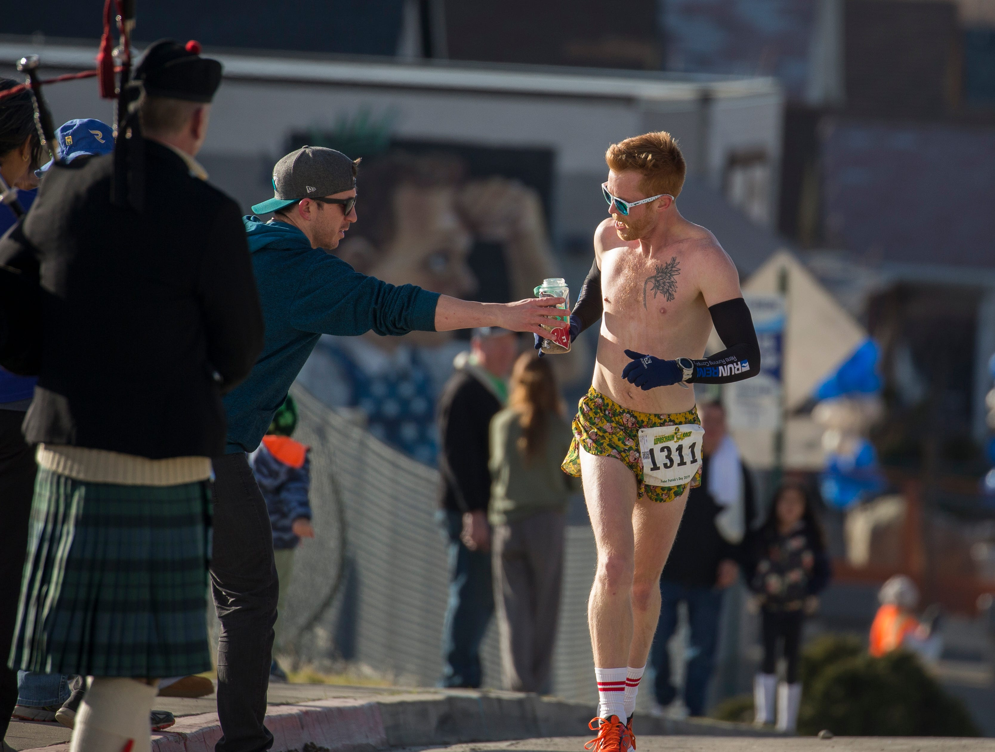 Race winner Salty McHooligan gets a drink as he approaches the finish line of the 7th annual Leprechaun Race in downtown Reno, Nevada on Sunday, March 17, 2019.