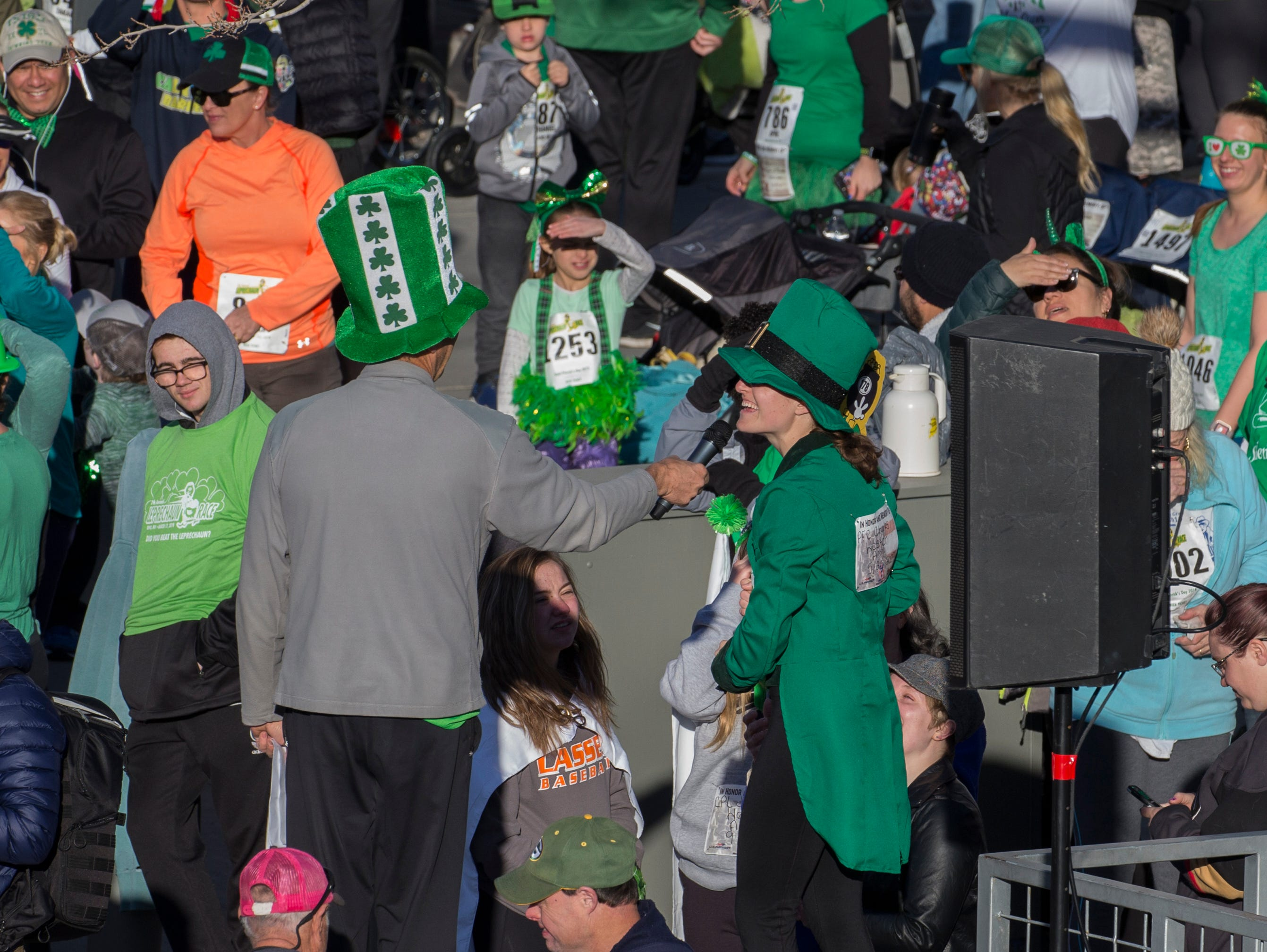 Race director Eric Lerude, center, talks with race Leprechaun Caitlin Howden before the start of the 7th annual Leprechaun Race in downtown Reno, Nevada on Sunday, March 17, 2019.