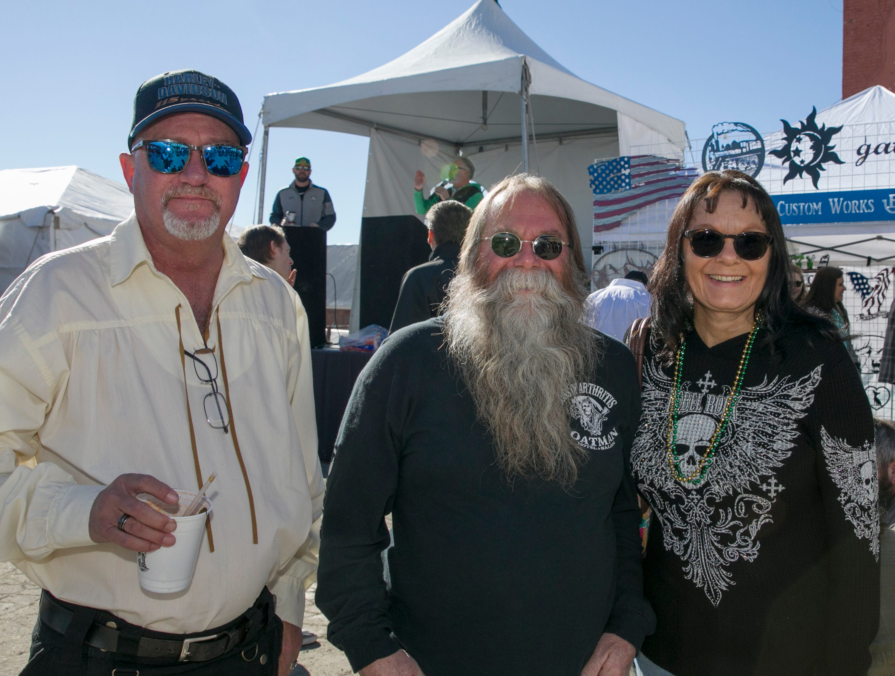 Rick, Mark and Debbie during the 28th annual Rocky Mountain Oyster Fry and St. Patrick's Day Parade in Virginia City, Nevada on Saturday March 16, 2019.