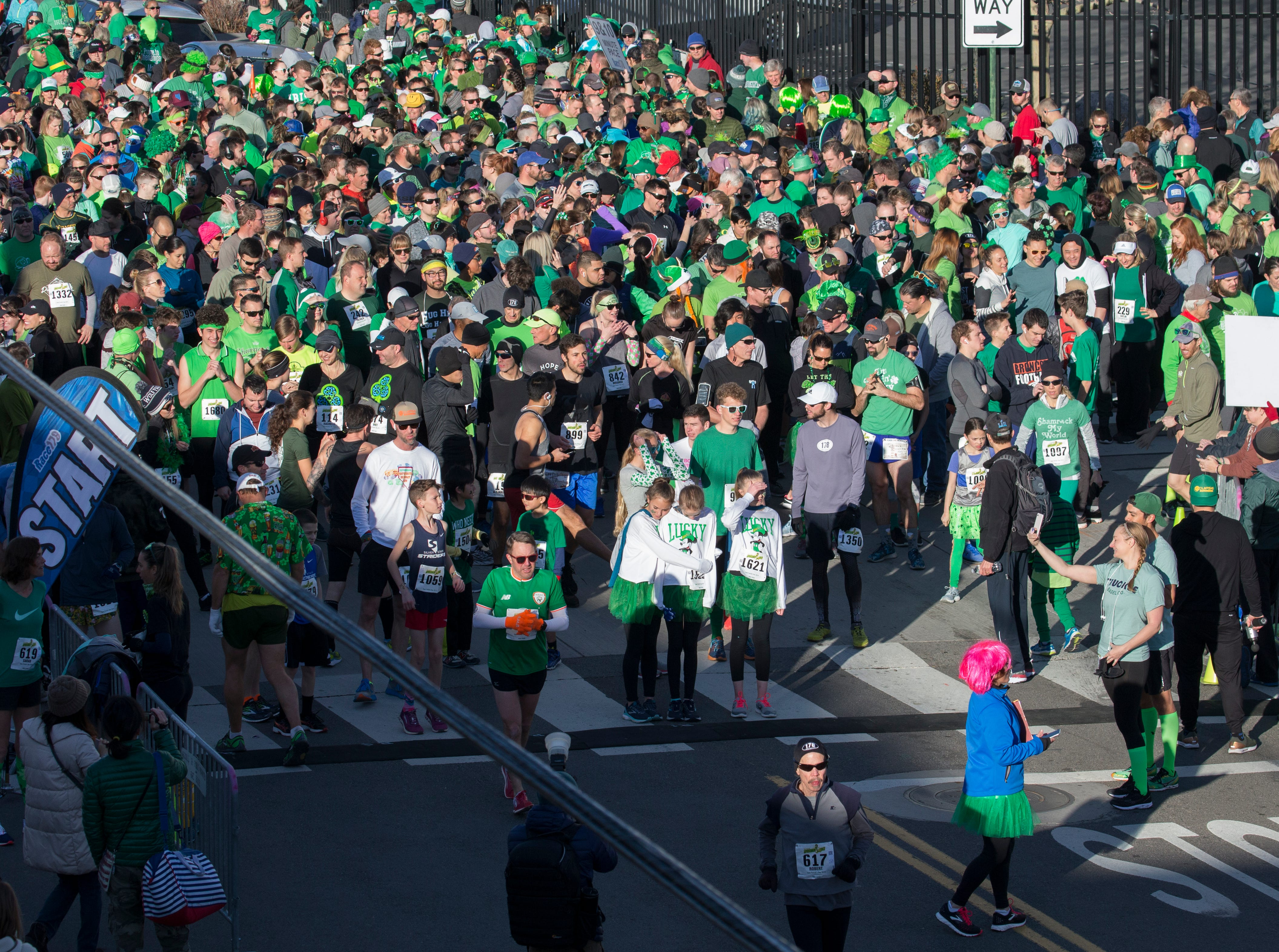 A record number of racers get ready to start the 7th annual Leprechaun Race in downtown Reno, Nevada on Sunday, March 17, 2019.