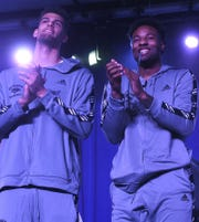 Nevada's Trey Porter, left, and Jordan Caroline react Sunday after learning Nevada would play Florida in the first round of the NCAA Tournament.