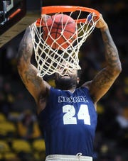 Nevada's Jordan Caroline dunks against Wyoming on Feb. 16, 2019, in Laramie, Wyo.