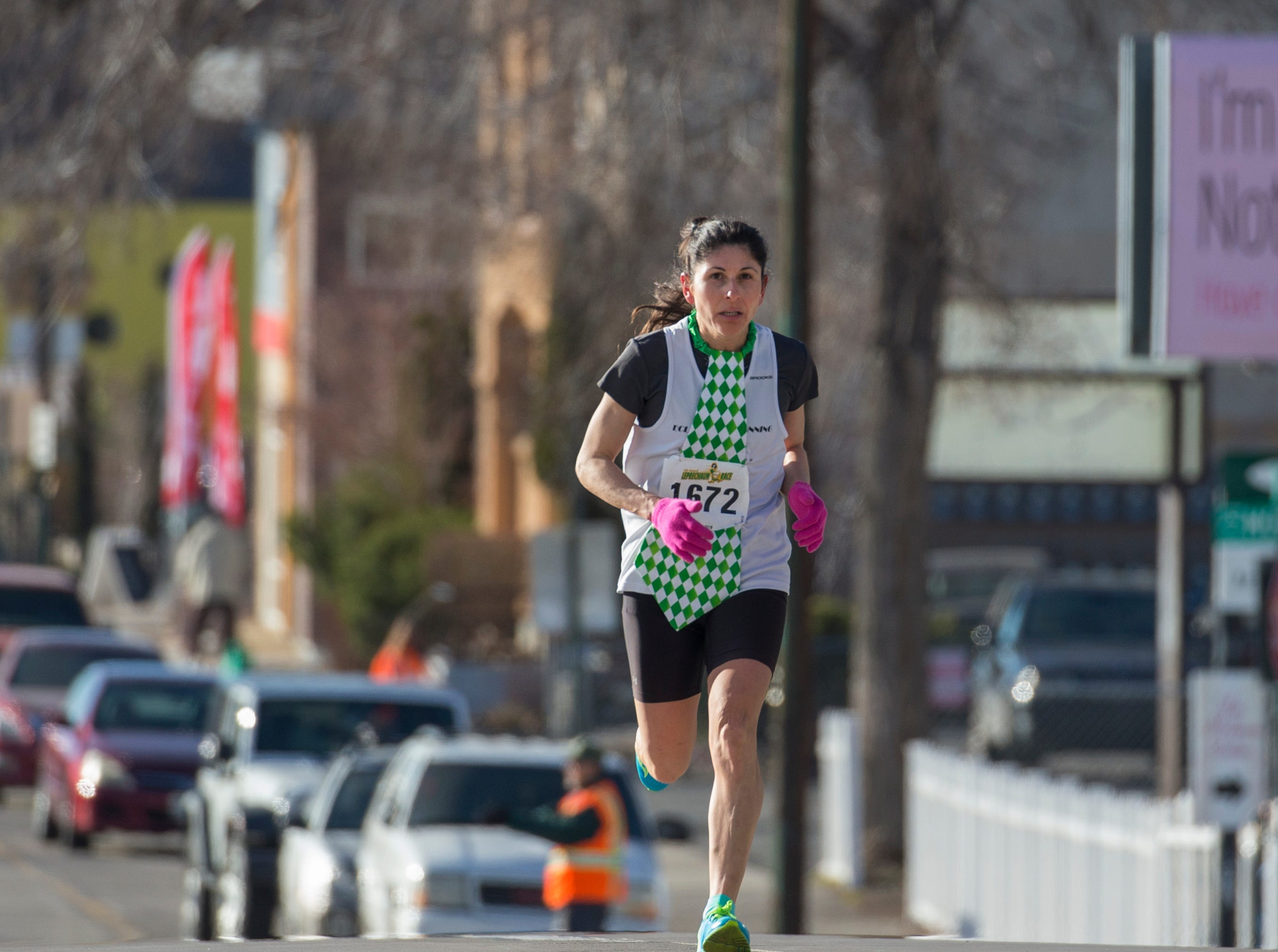 Women's winner Ramona Sanchez approaches the finish line during the 7th annual Leprechaun Race in downtown Reno, Nevada on Sunday, March 17, 2019.